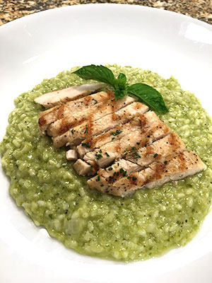 Grilled chicken on pesto risotto